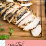 pinterest graphic with text shwoing coastal marinated grilled chicken sliced on a cutting board