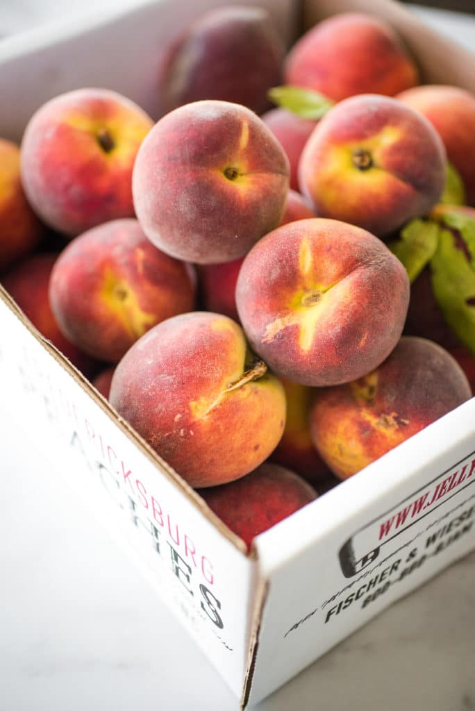 box of fresh peaches