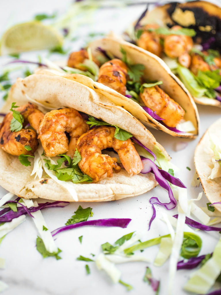chili lime shrimp tacos in charred white corn tortillas with cabbage slaw