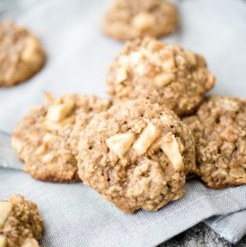 apple cinnamon oatmeal cookies on a grey cloth