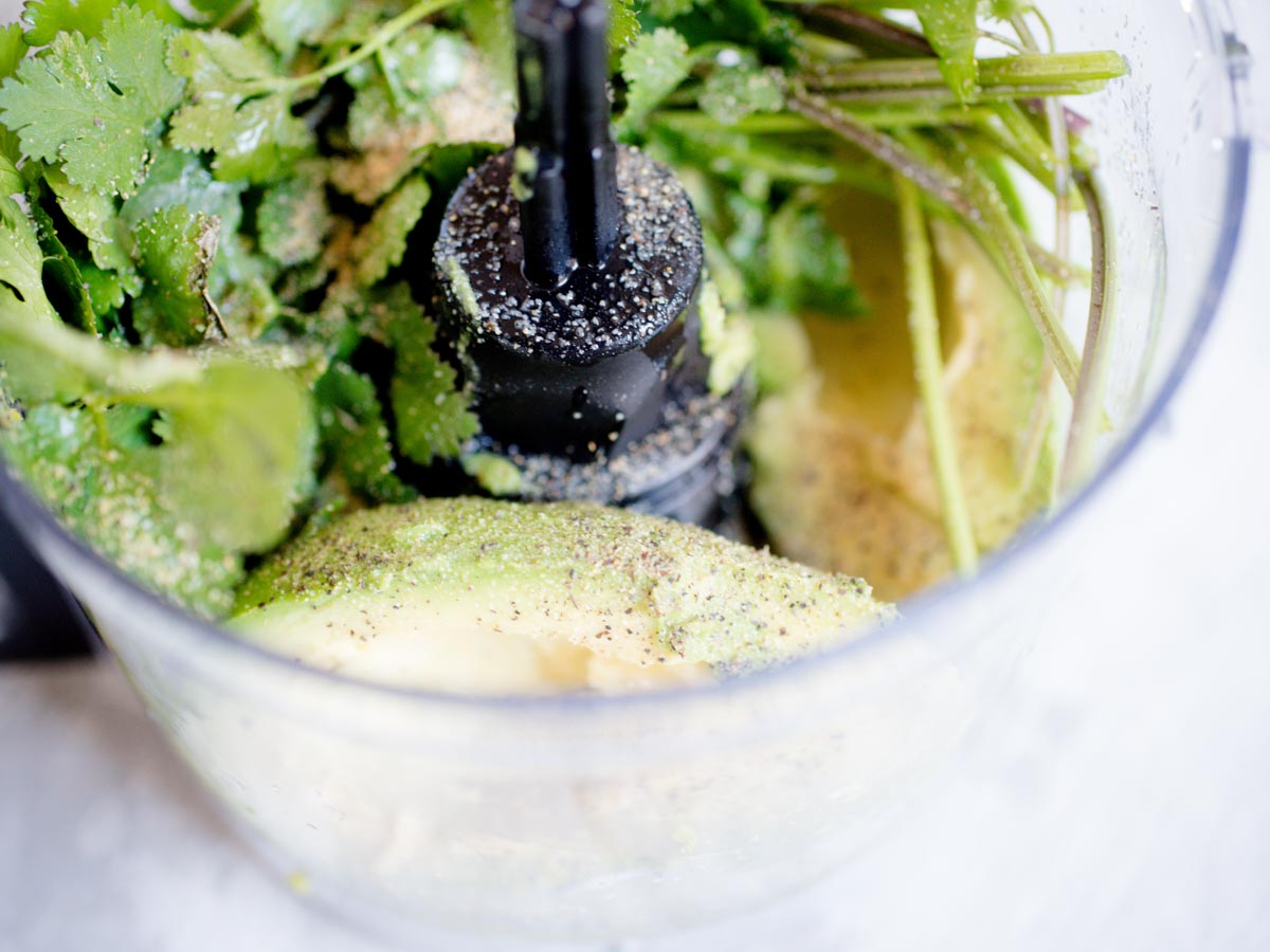 avocado and cilantro in food processor