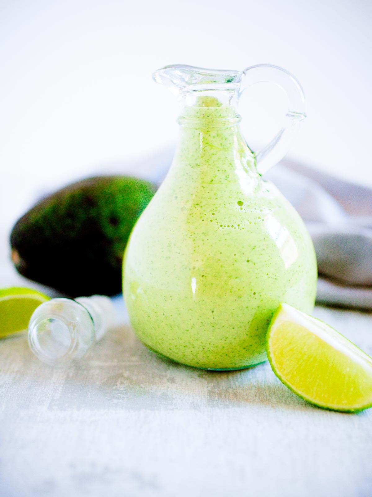 avocado cilantro dressing in a glass jar