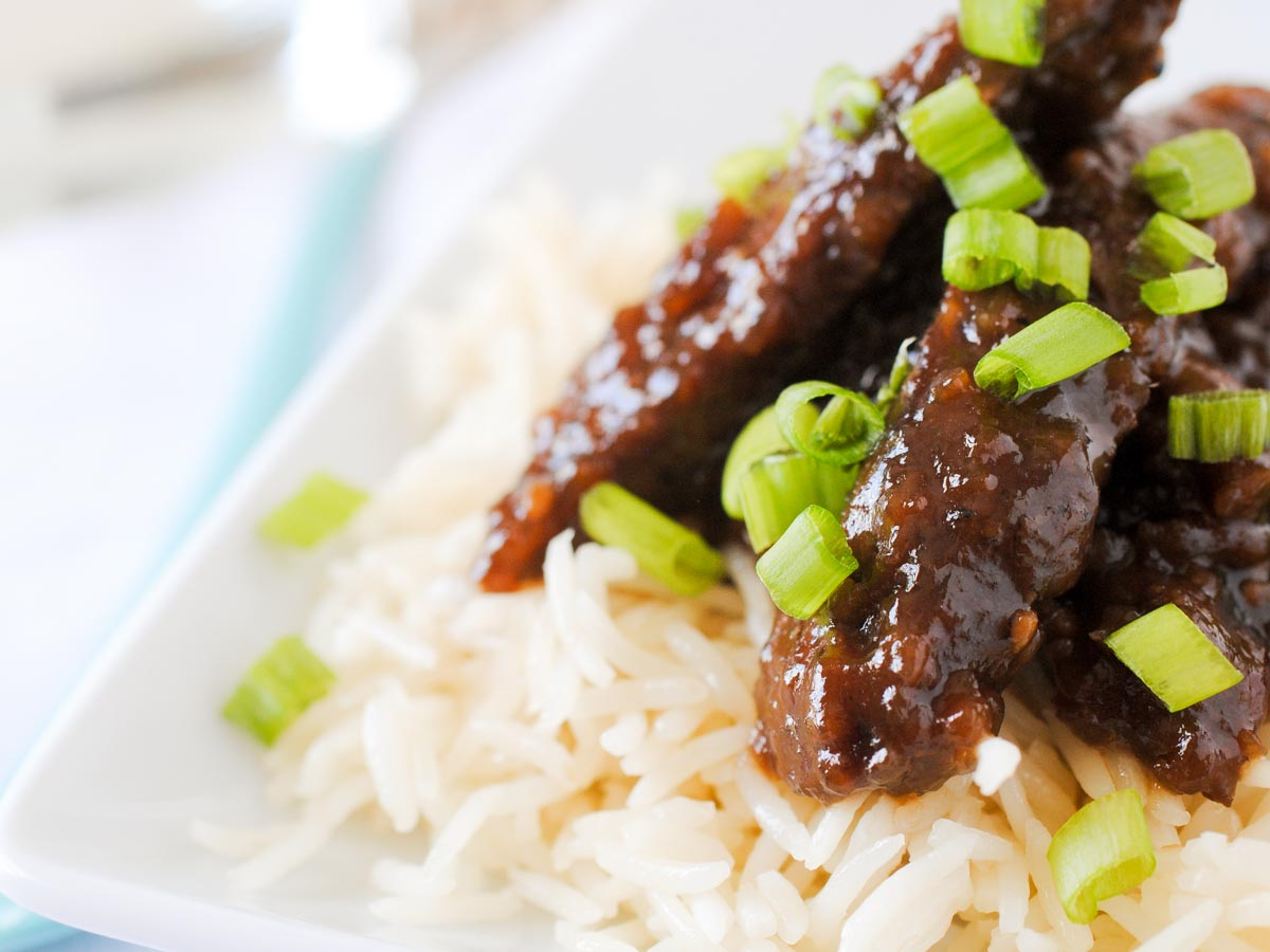 beef teriyaki on rice topped with green onion