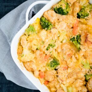 Cheesy Chicken and Veggie Bubble Up in a white baking dish
