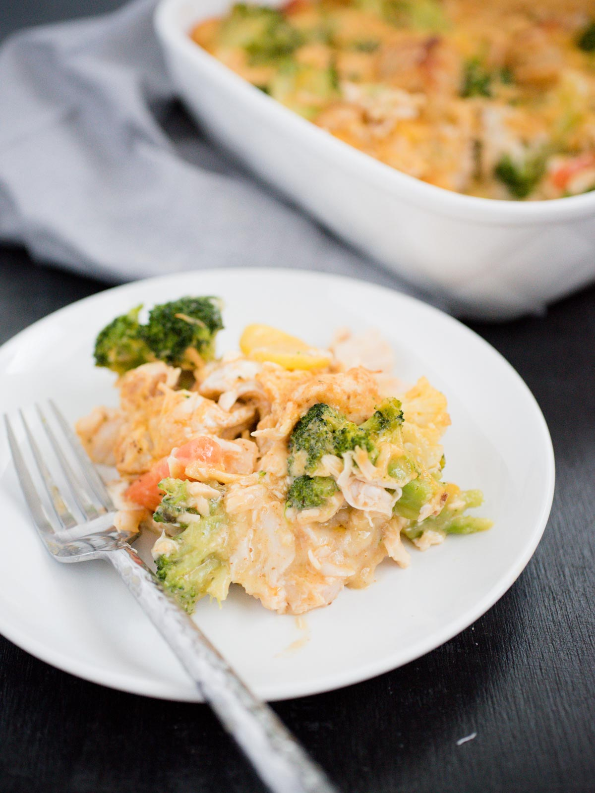 serving of Cheesy Chicken and Veggie Bubble Up on a white plate with a fork