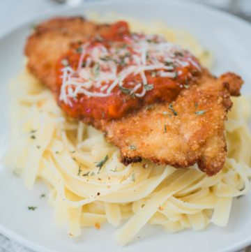 chicken parmesan on top of pasta