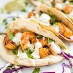 side shot of chili lime shrimp tacos