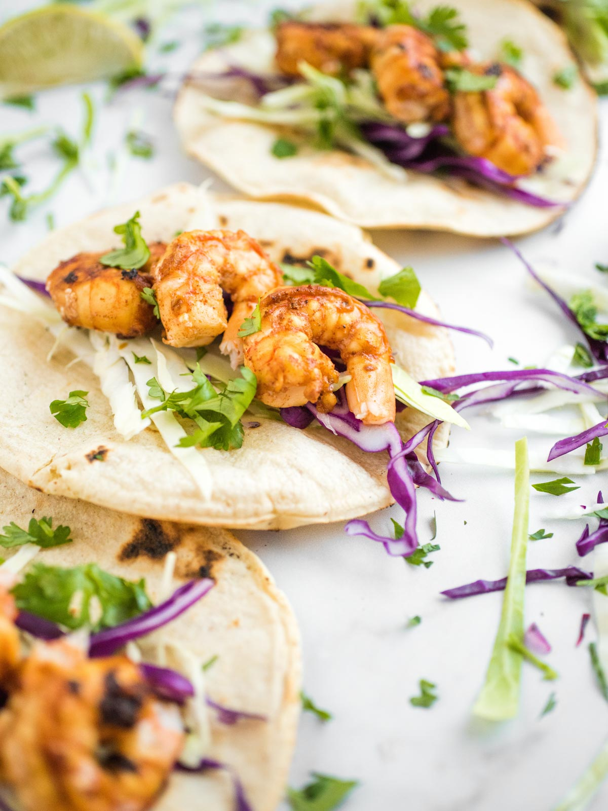 shot of chili lime shrimp tacos opened up