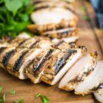 sliced chicken on cutting board