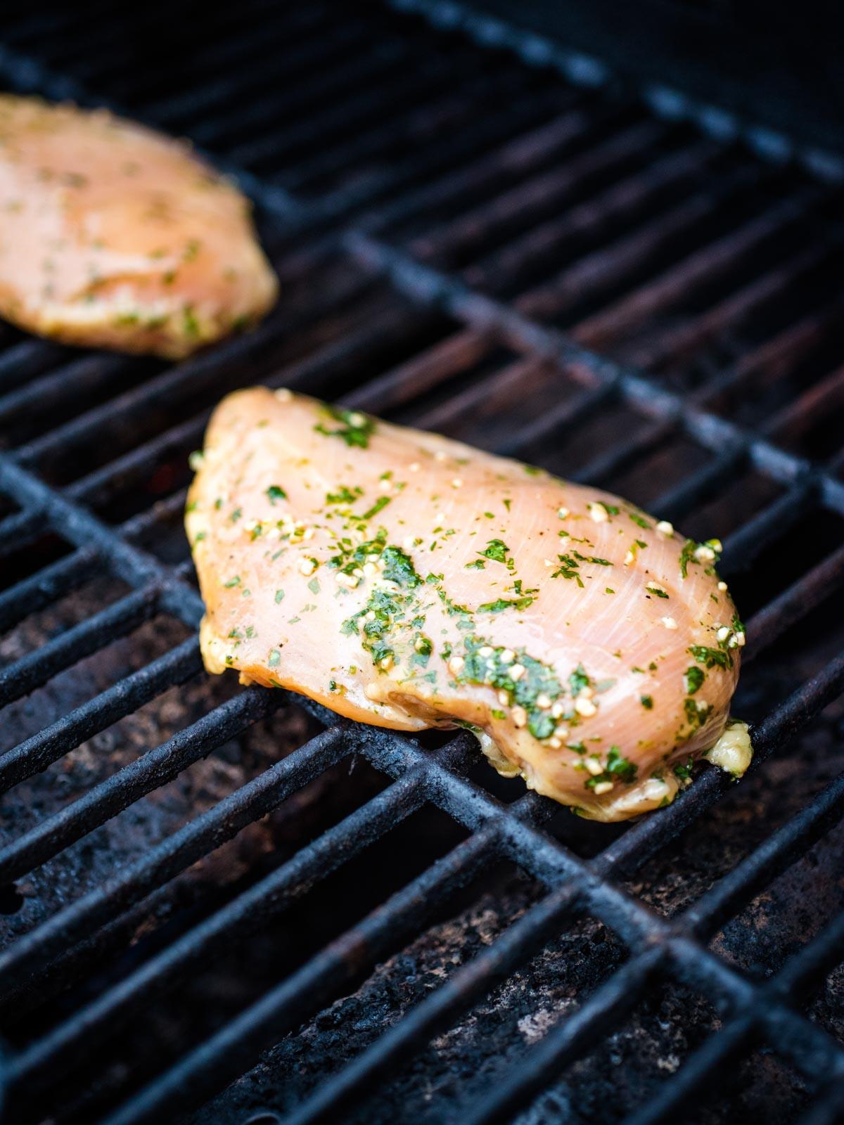seasoned marinated chicken on grill