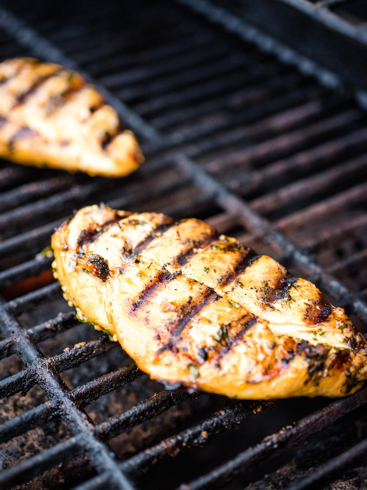 cooked chicken on grill showing grill marks