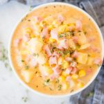 white bowl of creamy ham and potato corn chowder