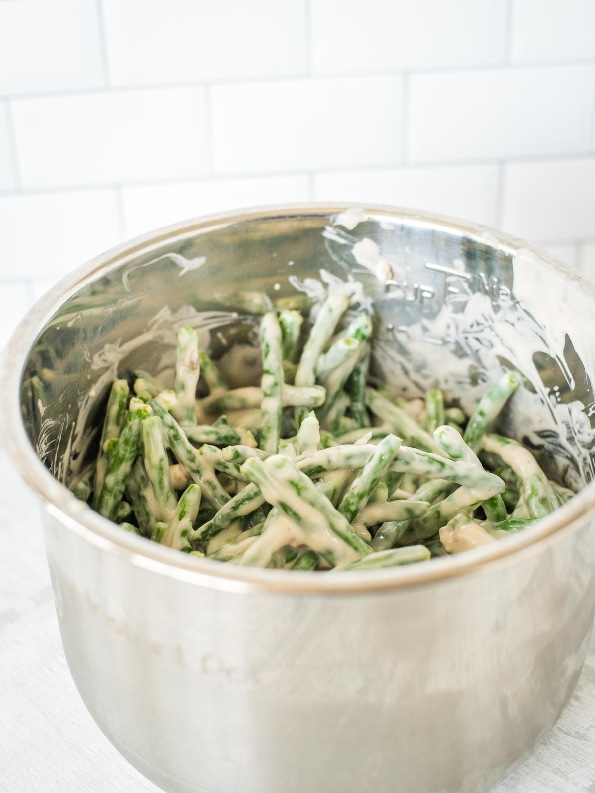 green bean casserole ingredients mixed together in instant pot sleeve
