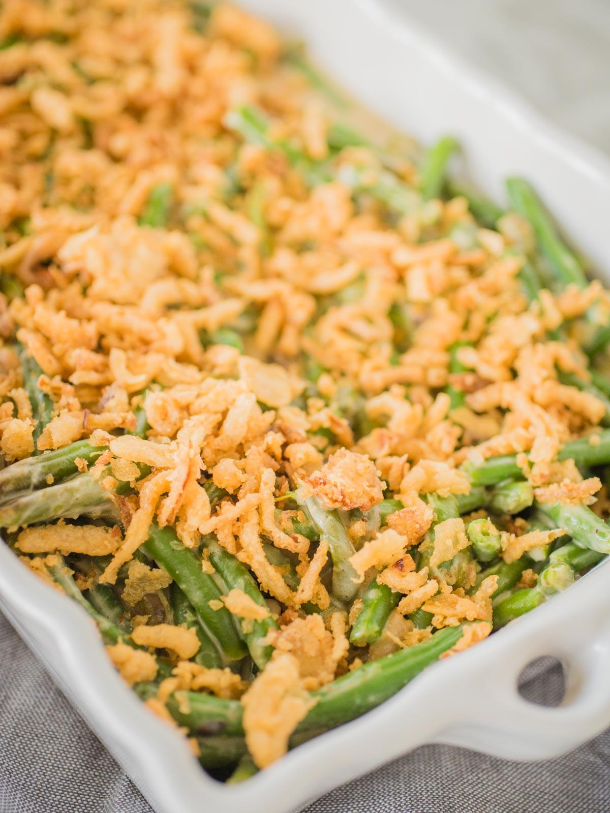 green bean casserole in a white serving dish
