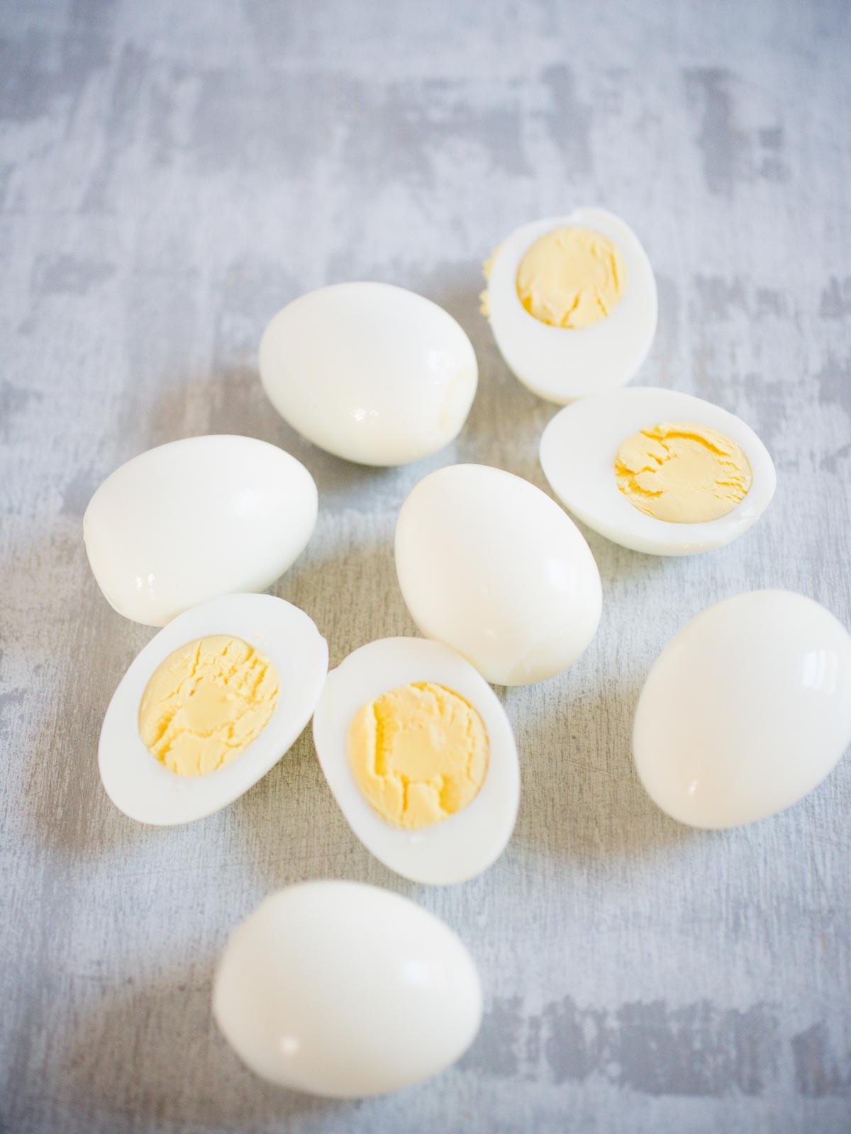 peeled hard boiled eggs with a few sliced