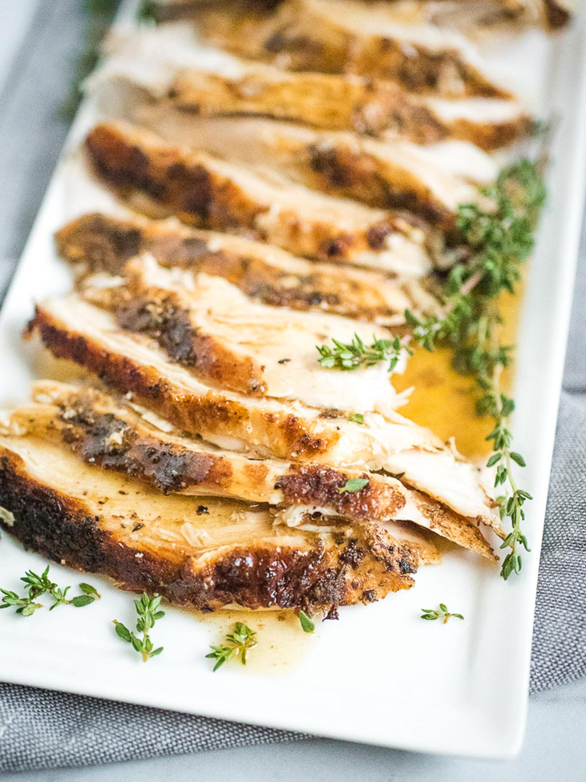 sliced turkey breast on plate with gravy