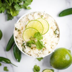 jalapeno lime rice topped with limes and cilantro