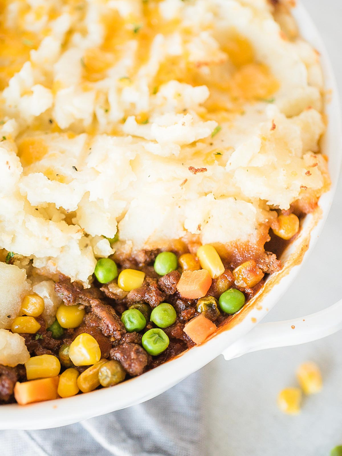 up close of inside of shepherds pie in a white baking dish