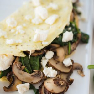 Spinach Mushroom and Feta Omelet on a white plate