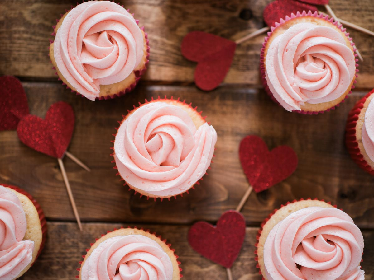 cupcakes with red liners and heart toppers