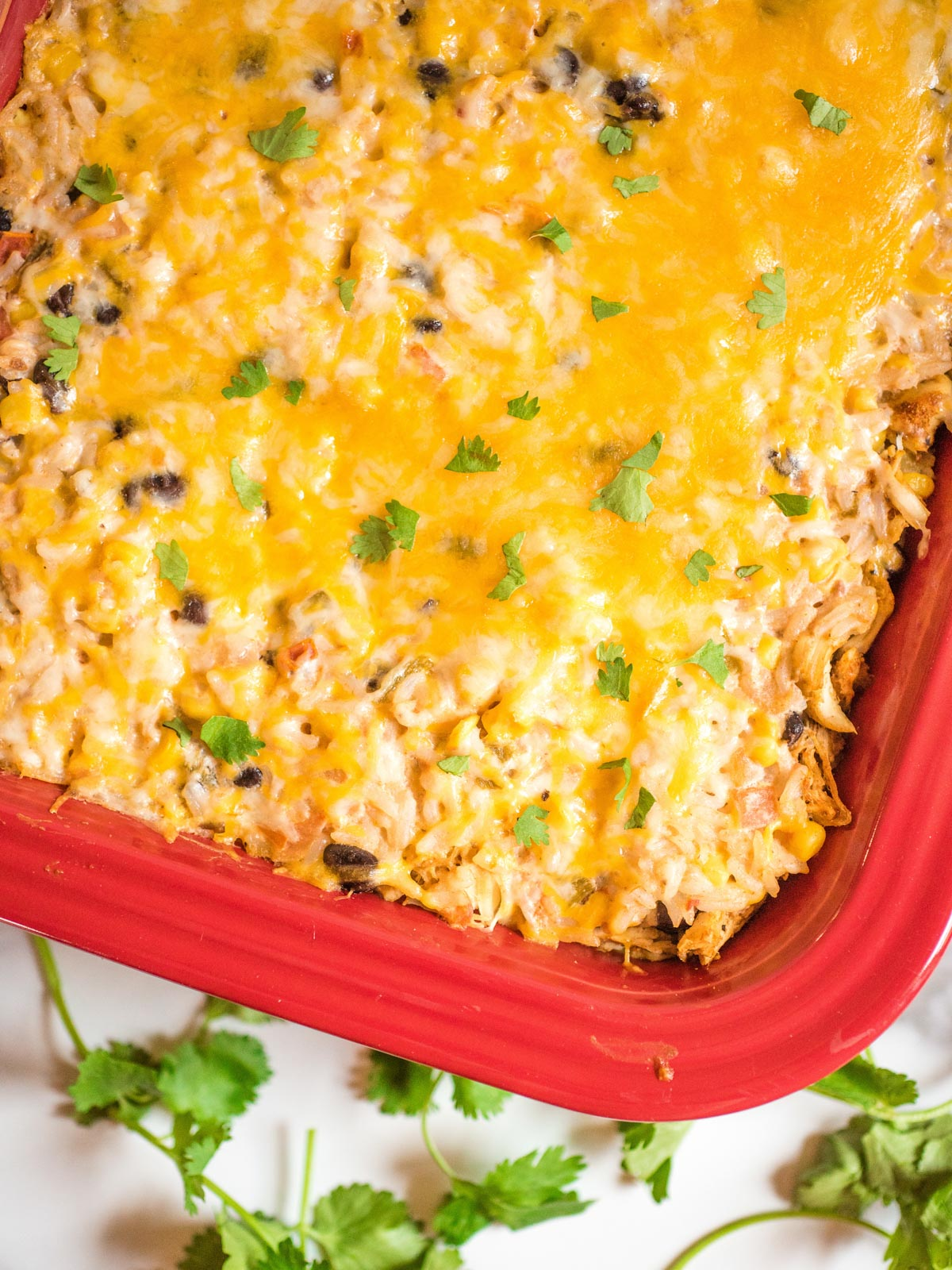 tex mex chicken and rice casserole in a red baking dish