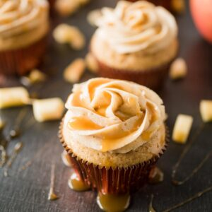 apple cider cupcake with cinnamon sugar frosting drizzled with caramel