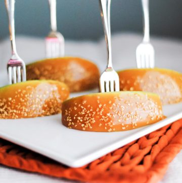 caramel apple bites on a plate with an appetizer fork