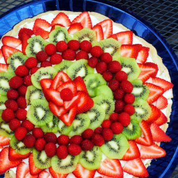 fruit pizza on a blue plate
