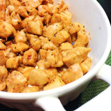 garlic brown sugar chicken in a white dish