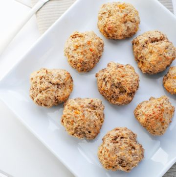 lighter sausage balls on a white plate