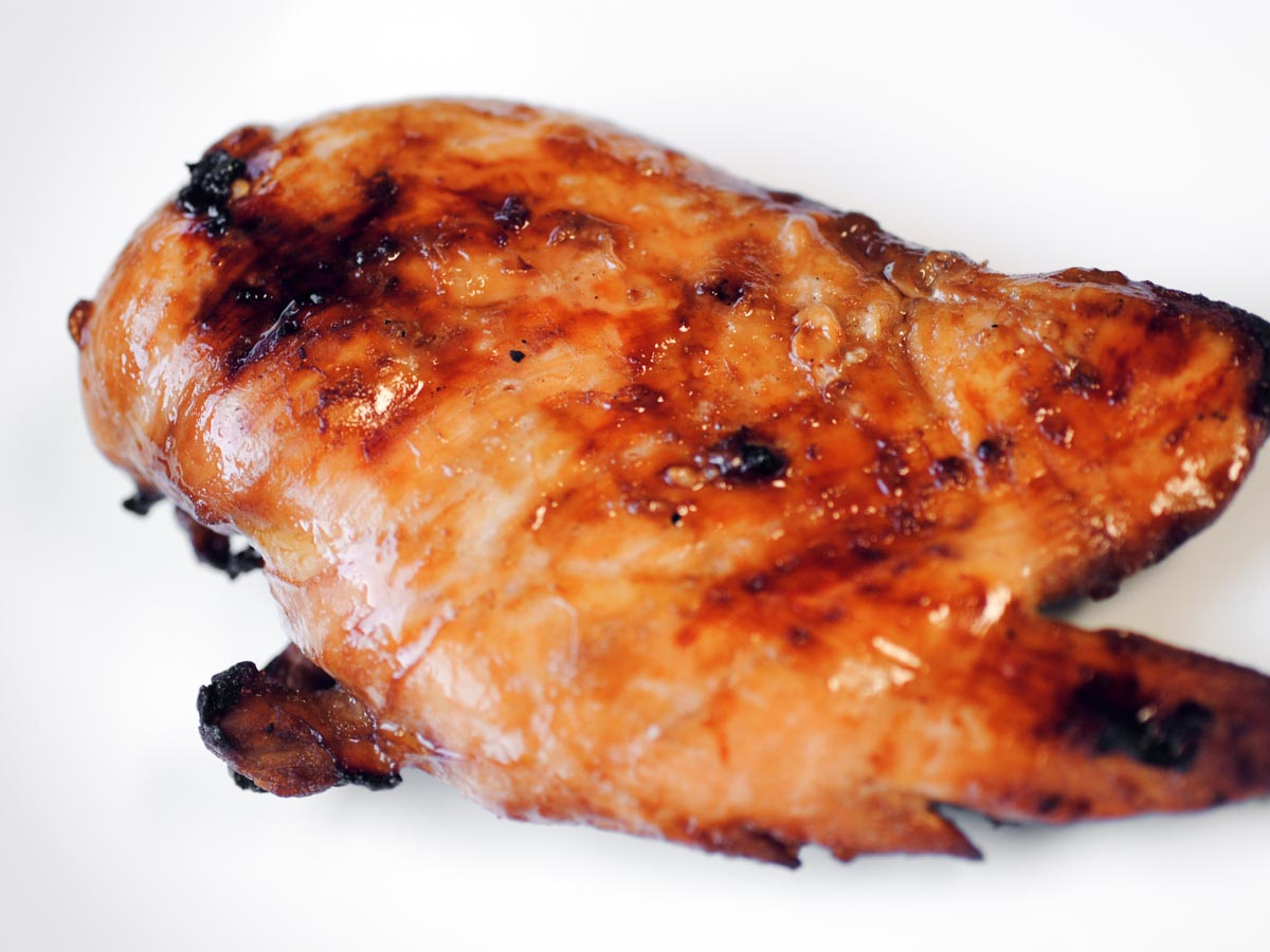 a piece of marinated grilled chicken
