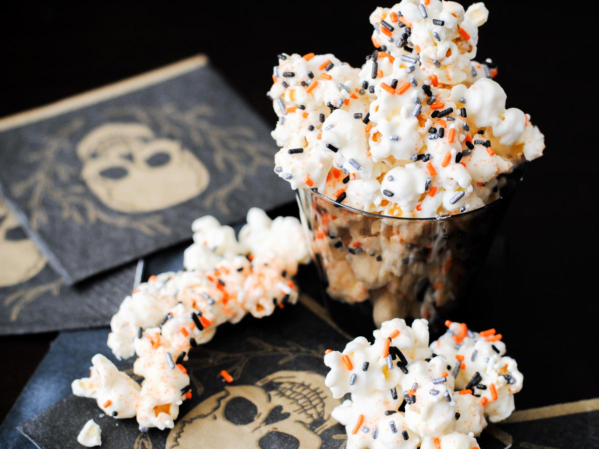 poison popcorn in a cup on a skull napkin