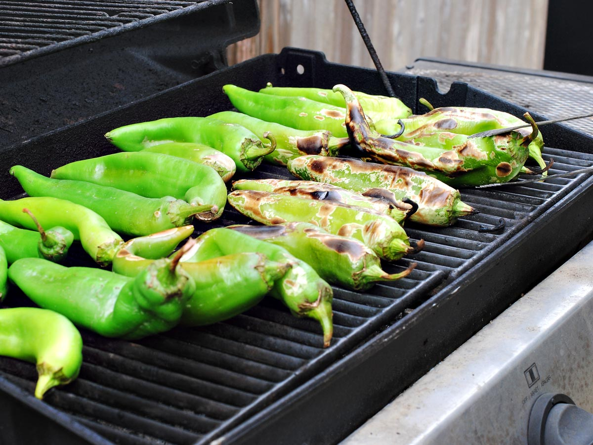 green chiles roasting on a grill