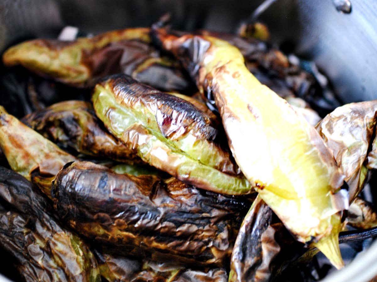 roasted green chiles in a pot