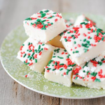 vanilla fudge with green and red sprinkles on a plate