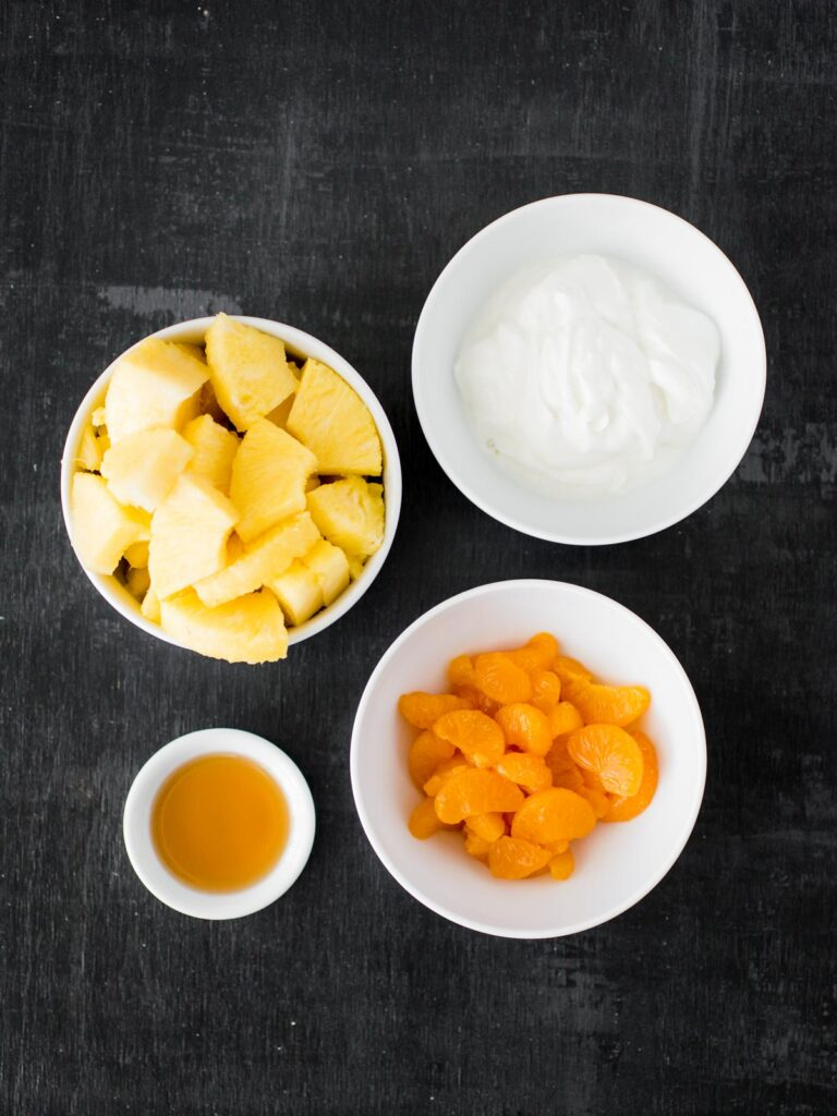 ingredients for candy corn inspired fruit parfait
