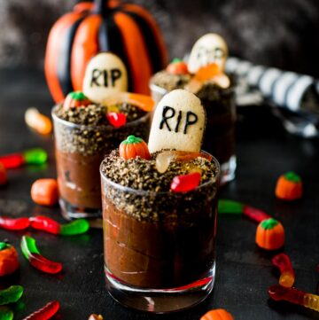 halloween dirt cups surrounded by toppings