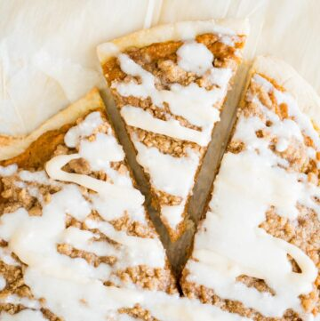 slice of pumpkin dessert pizza cut from a whole pizza