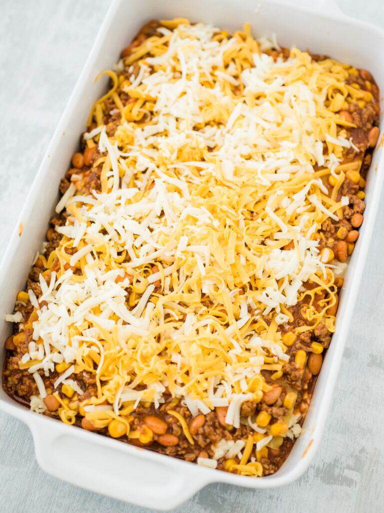 unbaked tex mex lasagna in a casserole dish