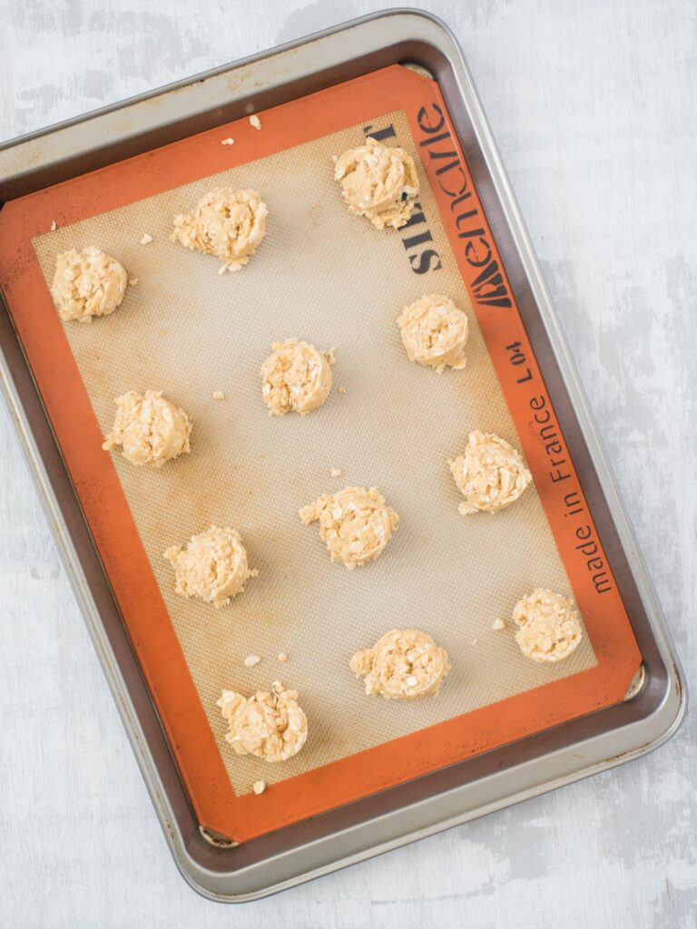 scooped cookies on a baking sheet