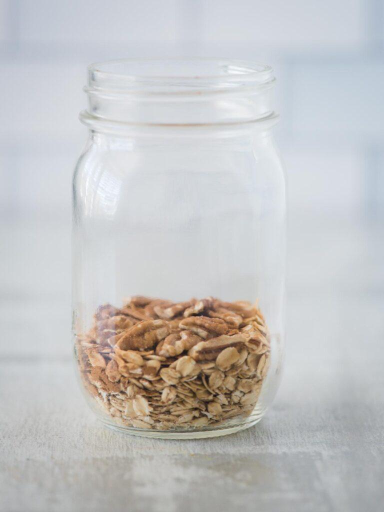 pecans added to jar of ingredients
