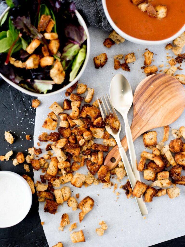 Homemade Croutons in the Air Fryer on parchment paper