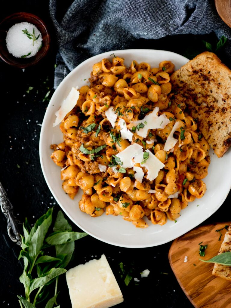 Instant Pot Ground Beef and Pasta with basil and shaved parmesan