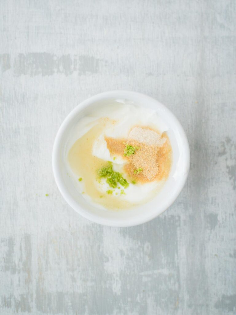 creamy lime sauce ingredients in bowl with lime juice