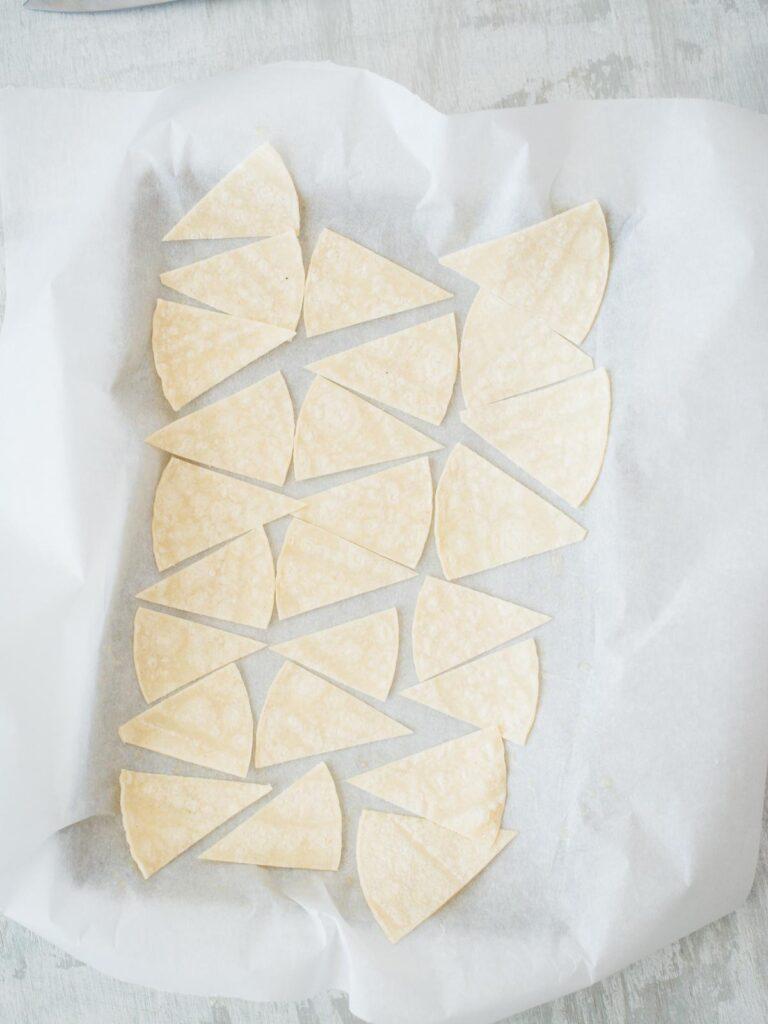 tortillas on baking sheet