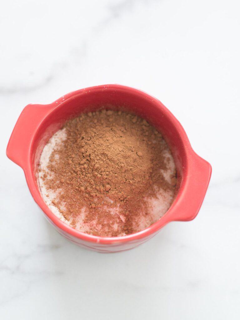 cocoa powder added to mug