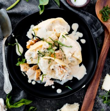 creamy chicken and ricotta stuffed shells topped with basil