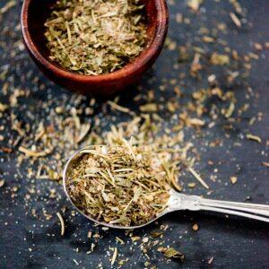 dried greek herbs in a spoon