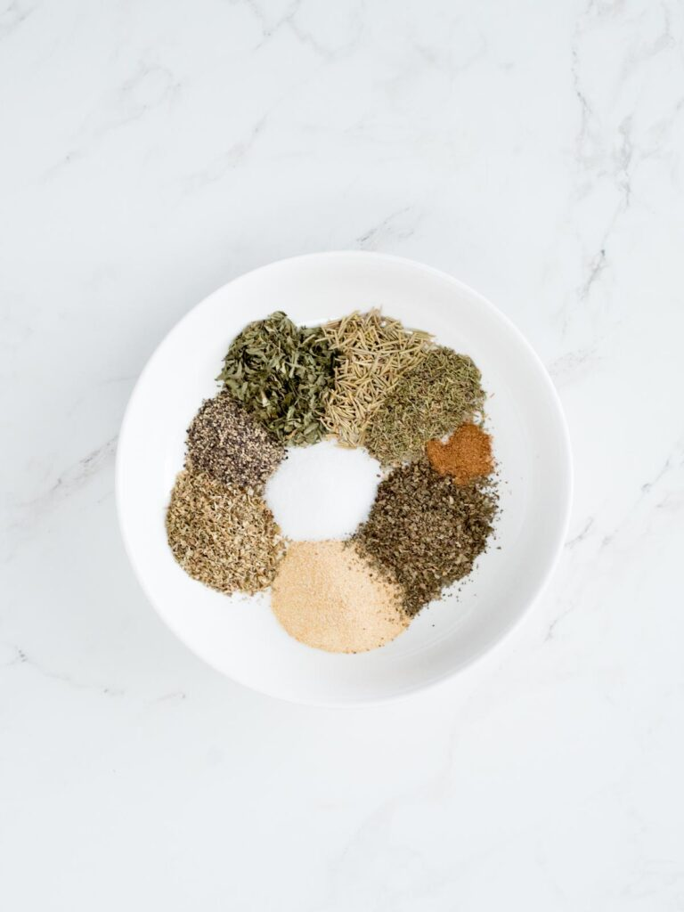 dried herbs and spice ingredients for Greek seasoning recipe