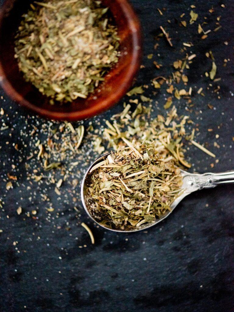 dried Greek herb seasoning in a spoon